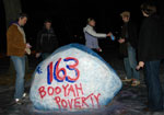 Shaun Groves spray-painting a rock at Northwestern: 163 kids sponsored!